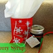 Cherry syrup in a jar with Christmas bag