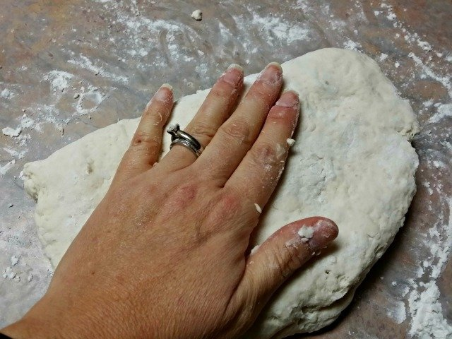 Gently kneading biscuit dough