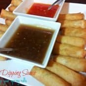 Spring rolls with two kinds of dipping sauce. This spring roll dipping sauce is ready in under 10 minutes and so easy. It's perfect for all your Asian appetizers! #asian #appetizer #dip #springroll