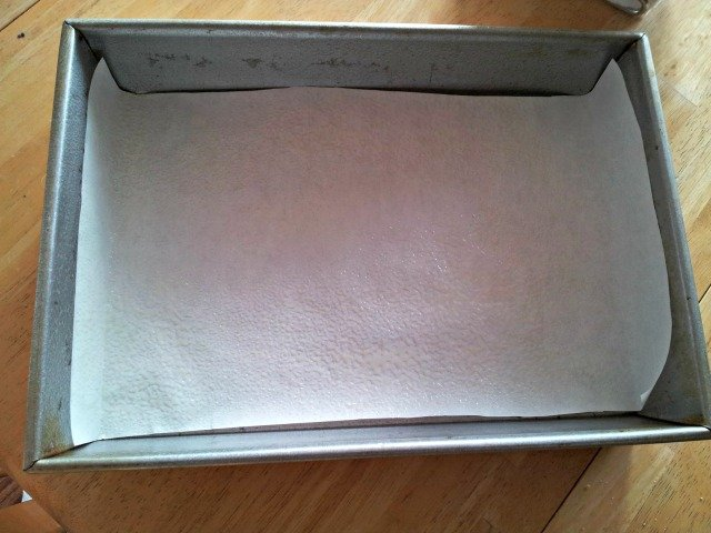 Line your brownie pan with parchment paper to help remove them easily once they've cooled