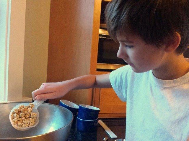 Adding Quaker granola to the bowl