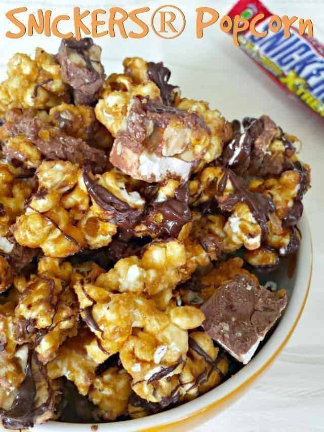 This Snickers popcorn recipe is a perfect sweet treat. Homemade caramel corn drizzled with chocolate and soft Snickers pieces inside combine for a delicious unique popcorn recipe. #popcorn #snickers #caramelcorn #homemade