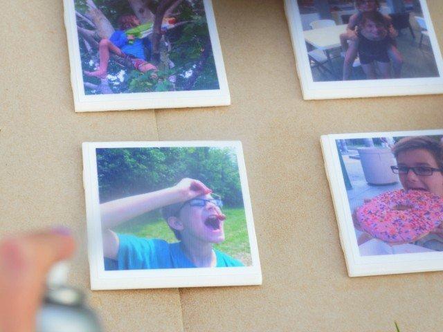 Apply spray acrylic to Modge Podge dried photo coasters