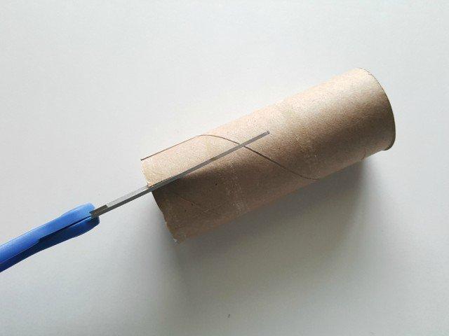 Cut one inch slits in cardboard tube