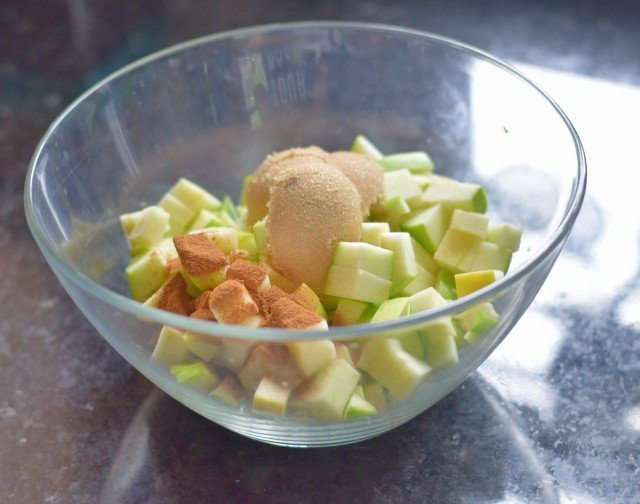 Add brown sugar and cinnamon to chopped apples