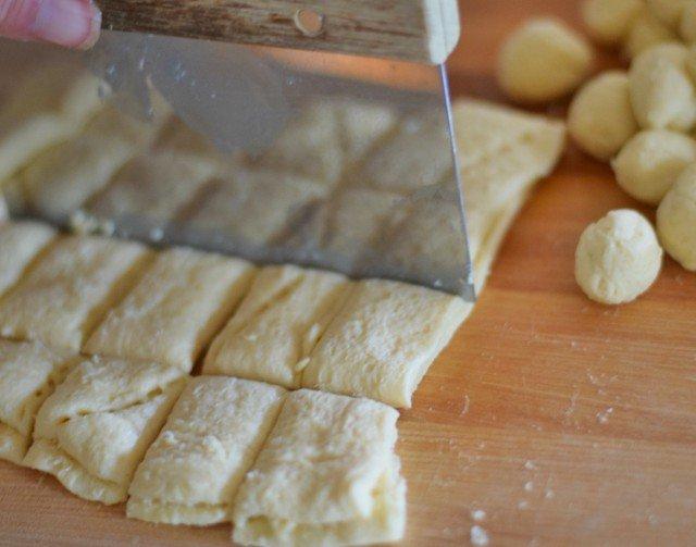 Use a bench scraper to cut the crescent roll dough