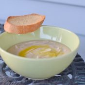 Bowl of gluten free Tuscan bean soup with crostini