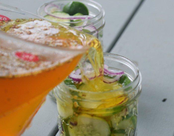 Pour brine into pickle jars