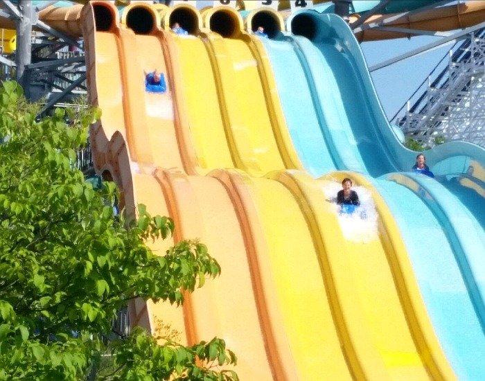 Enjoying water rides at the theme park