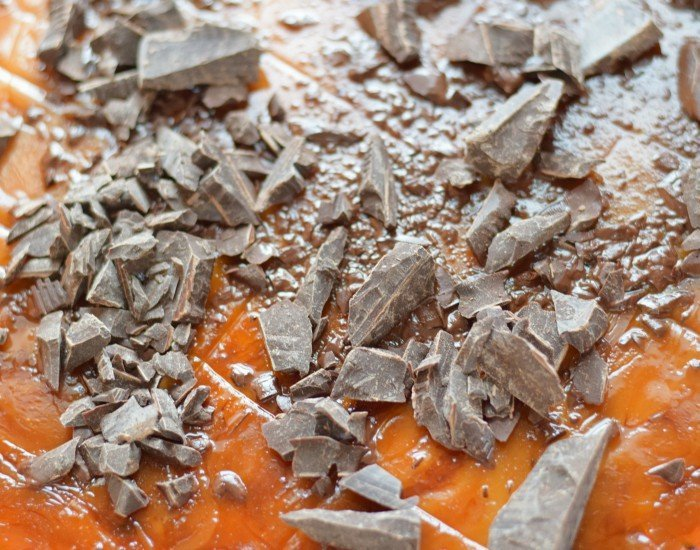 Add chopped chocolate to warm toffee