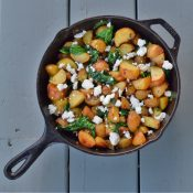 Skillet roasted potatoes with garlic and spinach