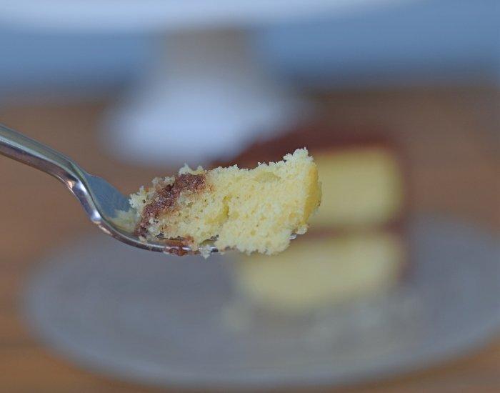 Bite of homemade yellow cake