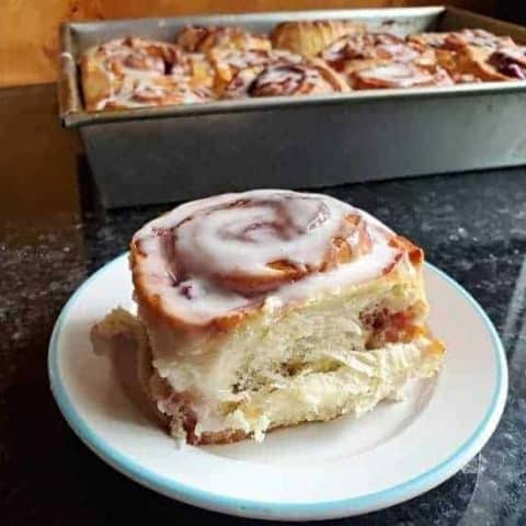 Plate with cherry cinnamon roll