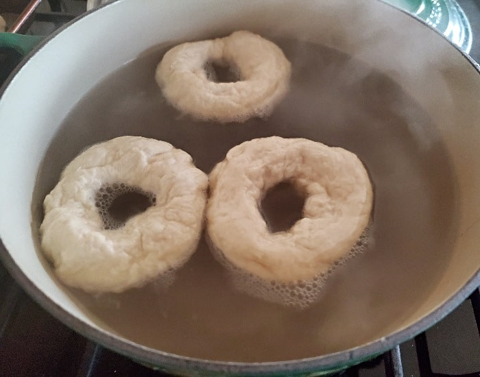 Bagels simmering to start cooking