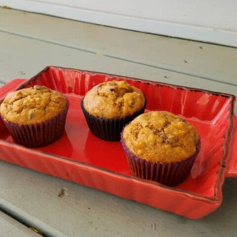 three muffins in a red tray