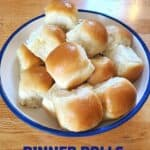Bowl of yeast dinner rolls on wood background