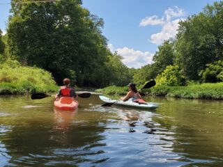 River kayaking with two teenagers.